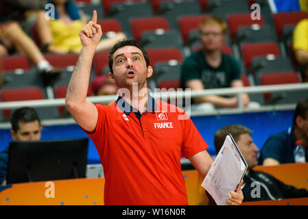 RIGA, LATVIA. 30th of June, 2019. Olivier Lafargue, assistant coach of team France, during European Women Basketball Championship, commonly called EuroBasket Women 2019 , game between team Sweden and team France in Arena Riga, Riga, Latvia. Credit: Gints Ivuskans/Alamy Live News - Stock Image