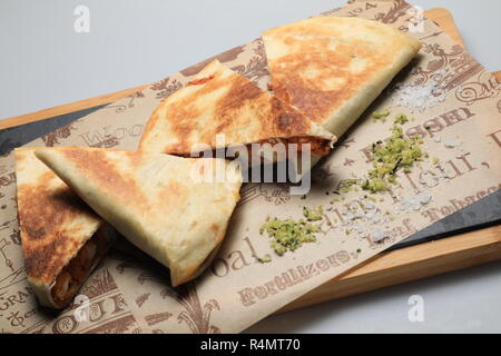 A shot of a tortilla sandwich cut in several pieces - Stock Image