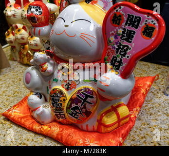 Maneki Neko lucky fortune cats on display at a restaurant - Stock Image
