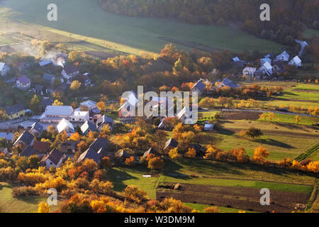 Autumnal landscape with village in Slovakia countryside - Stock Image