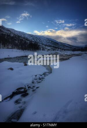 River running through the snow - Stock Image