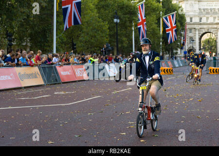 A man riding along The Mall with onlooking crowd, Brompton World Championships 2018, London, UK - Stock Image