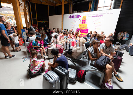 Passengers inside the Billi terminal, Bordeaux airport, Bordeaux France Europe - Stock Image