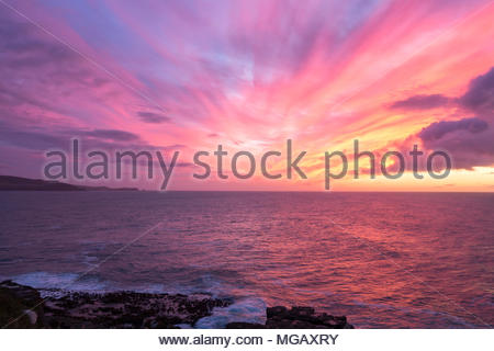 Colorful sunrise over the ocean, Southland, New Zealand - Stock Image