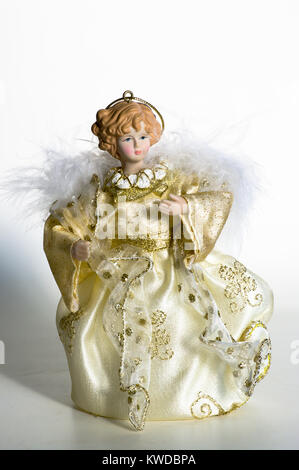 Small Christmas tree decoration of doll in a fine ornate gown - Stock Image
