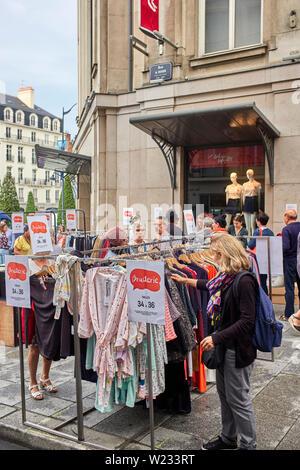 Street sale outside Gallerie Laffayette, Rue de Rohan, Rennes the capital of Brittany, France - Stock Image