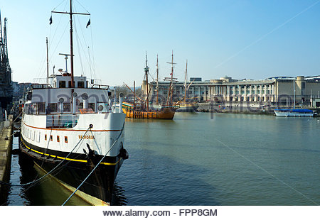 Bristol Floating Harbour scene, with vintage shipping and the Lloyds amphitheatre building in the background. Bristol, - Stock Image