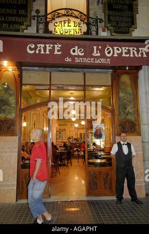 Spain Barcelona Ramblas Cafe de Opera people - Stock Image