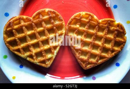 Valentine's Day breakfast treat, heart shaped waffles - Stock Image