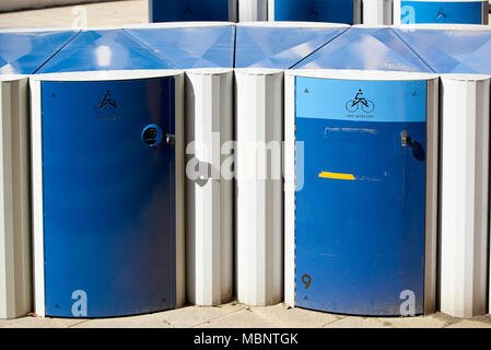 Blue bycicle lockers at University of Central Lancashire. - Stock Image