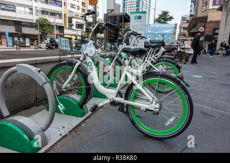 Bicycles for hire at a docking station at Chungmuro Station in Seoul, South Korea. - Stock Image
