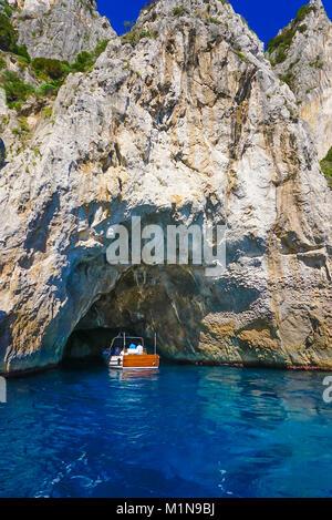 The White Grotto of the island of Capri, Italy.  Coastal Rocks on the Mediterranean Sea at Capri Island from a motor - Stock Image