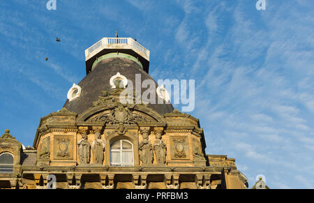 Birds flying over the The top of the Grand Hotel Scarborough, a Victorian building with ornate carved stonework. unsharpened. - Stock Image