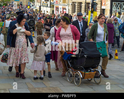 October 2018 women and children dressed in period civilian clothes worn during  World War two at an annual re-enactment in Pickering North Yorkshire - Stock Image