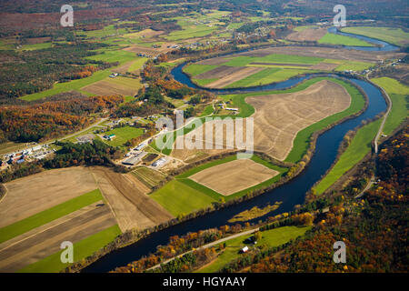 The Connecticut River flows through farmland in Newbury, Vermont and Haverhill, New Hampshire.  Aerial. - Stock Image