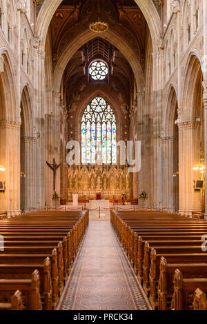 Aisle down the centre of Armagh Cathedral, Northern Ireland. - Stock Image