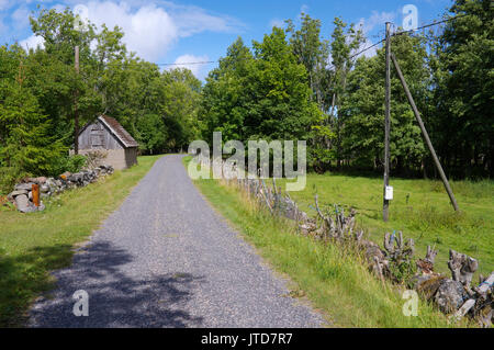Kihnu village road. Island Kihnu, Estonia, Baltic States, 5th August 2017 - Stock Image
