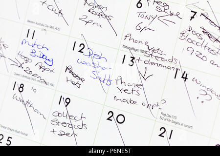Busy schedule, busy calendar, appointments, things to do, to do list, full calendar, calendar, overworked, schedule, reminder, reminders, appointments - Stock Image