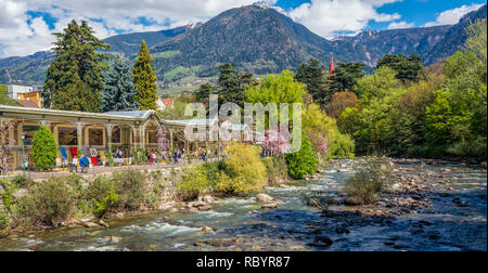 Meran in South Tyrol, a beautiful city of Trentino Alto Adige, View on the famous promenade along the Passirio river. Northern Italy - Stock Image