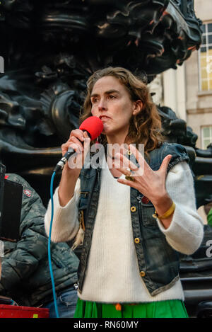 London, UK. 16 February 2019. Venus CuMara speaks. The 16th 'Reclaim Love' free Valentine's Day street party takes place around the statue of Eros in Piccadilly Circus, with drumming, music, dancing poetry to celebrate love. The event, which was founded by poet Venus CuMara, aims to reclaim love as a manifestation of the human spirit from the sleazy commercialisation which has taken over Valentine's Day as a festival of profit.  ake part and speak about Credit: Peter Marshall/Alamy Live News - Stock Image