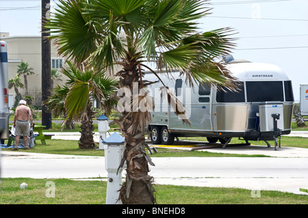 Camper with campervan RV in campground at campsite camping in Galveston, Texas, USA - Stock Image