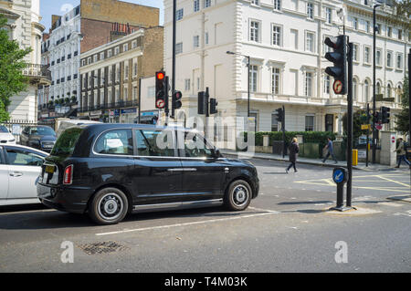 LEVC electric black taxi at a junction in Paddington, London - Stock Image