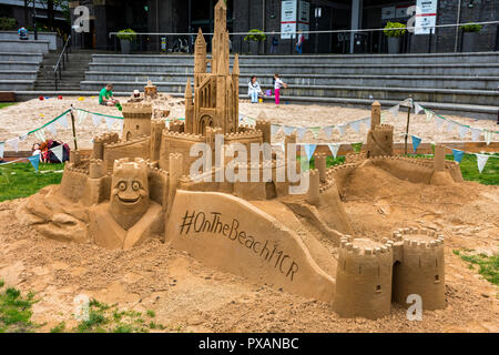 Sand castle display by #onthebeachMCR at Great Northern Square, Manchester, England, UK - Stock Image