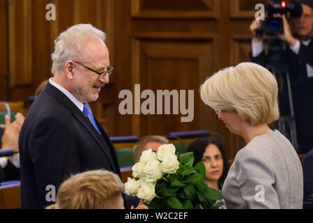 RIGA, LATVIA. 8th of July 2019. RIGA, LATVIA. 8th of July 2019. Inara Murniece (R) Speaker of Latvian Parliament, giving flowers to Egils Levits, Newly elected President of Latvia, Solemn oath and address at the extraordinary session of the Saeima (Latvian parliament). Credit: Gints Ivuskans/Alamy Live News - Stock Image