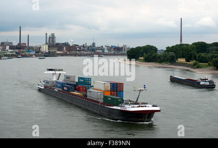 'Factotum' container barge river Rhine, Leverkusen, North Rhine-Westphalia, Germany. - Stock Image