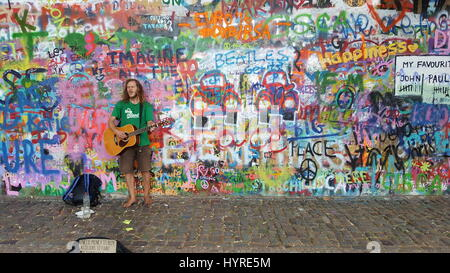 Singing for money to by colours to paint - Stock Image