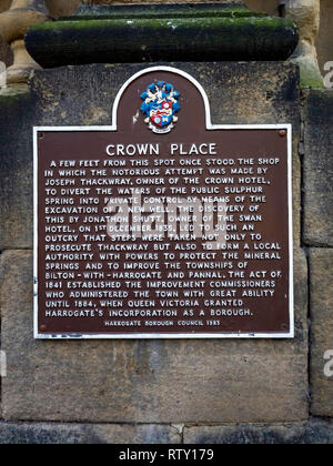 A Brown information sign on Crown Place Harrogate relating how a hotel owner in 1835 had tried to divert the Spa water for private use - Stock Image