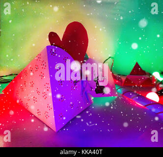 Christmas Decoration with Cake slice Gifts and Cake slice under snow with multi color lighting for best background - Stock Image