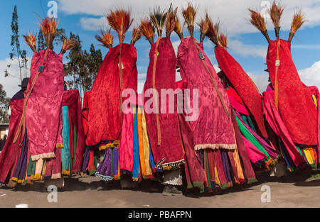 Indigenous Salasaca Indians in colourful garments, celebrating the Inti Raymi festival - or Festival of the Sun, Salasaca, Andes, Ecuador, June 2004. - Stock Image
