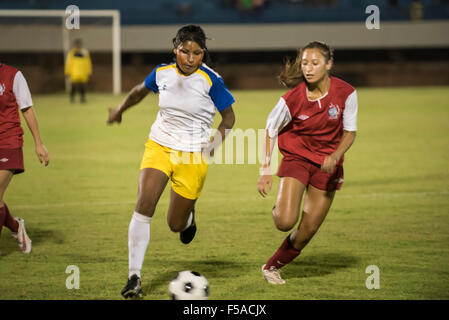 Palmas, Brazil. 30th October, 2015. Two women compete for the ball during the final of the women's football, - Stock Image