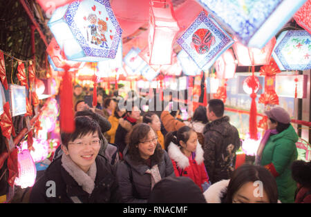 (190218) -- WUHAN, Feb. 18, 2019 (Xinhua) -- People view lanterns at Baibuting Community's cultural gallery in Wuhan, capital of central China's Hubei Province, Feb. 18, 2019. Many places across the country are decorated with lanterns to celebrate the upcoming Lantern Festival, which falls on Feb. 19 this year. (Xinhua/Xiao Yijiu) - Stock Image