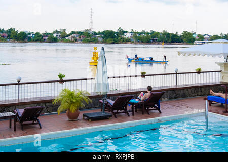 View from swimming pool in Victoria Chau Doc Hotel beside Hau River in Mekong Delta. Chau Doc, An Giang Province, Vietnam, Asia - Stock Image