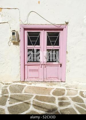 Pink double door, Greece - Stock Image