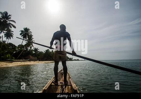 Fisherman in dugout canoe, Yele Island, the Turtle Islands, Sierra Leone. - Stock Image