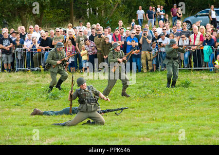 ENSCHEDE, THE NETHERLANDS - 01 SEPT, 2018: German soldiers fighting and shooting during a military army show for public. - Stock Image
