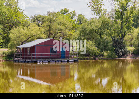 A floating fishing dock on a lake in Sedwick County park in Wichita, Kansas, USA. - Stock Image