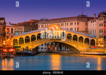 Sunset in Venice with the view to the Rialto Bridge over the Grand Canal - Stock Image