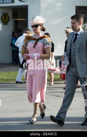 Chichester, West Sussex, UK. 14th Sep, 2013. Goodwood Revival. Goodwood Racing Circuit, West Sussex - Saturday 14th September. A visitors arrives dressed in period clothing. Credit:  MeonStock/Alamy Live News - Stock Image