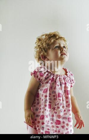 Child. Portrait of a child, 18 months, looking upwards. Model released. Studio shot.      Ref: CRB538_103609_0002  COMPULSORY CREDIT: Martin Harvey / - Stock Image