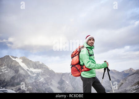 Portrait of hiker in cold conditions, Mont Cervin, Matterhorn, Valais, Switzerland - Stock Image