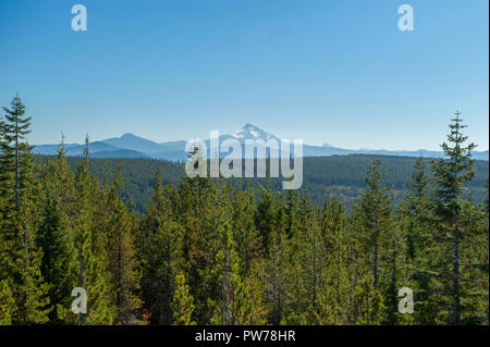 Oregon's Mt. Jefferson and other volcanoes as seen from High Rock, the site of a former fire and WWII enemy aircraft lookout about thirty miles away.  - Stock Image