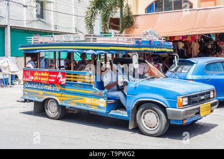 Phuket, Thailand - May 20th 2010: Traditional, blue public bus. This is typical of bus transport on the island. - Stock Image