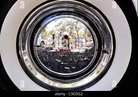 Photographer's reflection in vintage Humber automobile hubcap - Stock Image