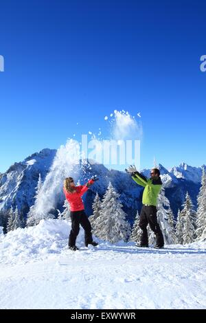 Two persons in snow, Tegelberg, Ammergau Alps, Allgaeu, Bavaria, Germany, Europe - Stock Image
