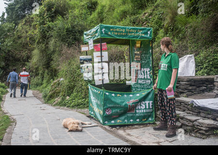 A volunteer from Waste Warriors standing by their booth in north India. - Stock Image