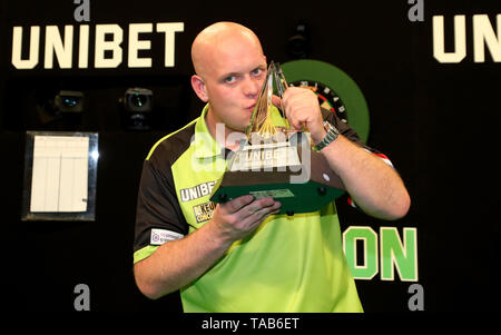 Michael Van Gerwen poses with his trophy after beating Rob Cross in the Premier League Play-Offs Final during the Premier League Play-Offs at The O2, London. - Stock Image